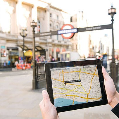 A man using Google Maps on an iPad to find his way around London, October 4, 2012. (Photo by Kevin Nixon/Future via Getty Images)