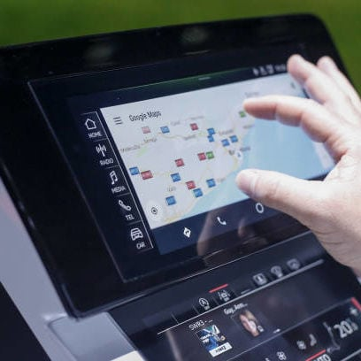 An attendee tests the Google Inc. maps application on the touch screen inside an Audi AG A8 sedan automobile during a launch event in Barcelona, Spain, on Tuesday, July 11, 2017. Audi chief executive officer Rupert Stadler faces his toughest test since taking the helm at Audi ten years ago, as Volkswagens biggest profit contributor grapples with declining sales and widening legal probes into its role in the diesel scandal. Photographer: Pau Barrena/Bloomberg via Getty Images