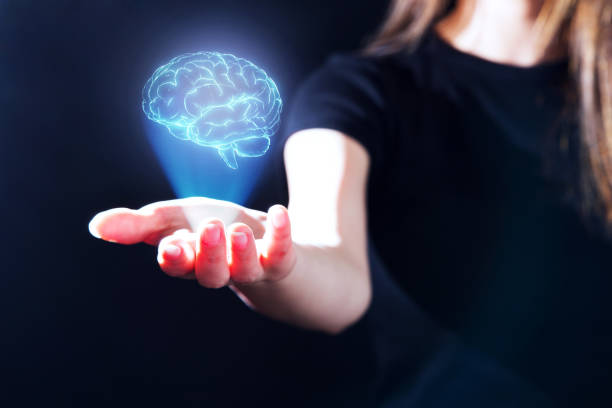 Woman's Hand Showing A Hologram Of Human Brain.